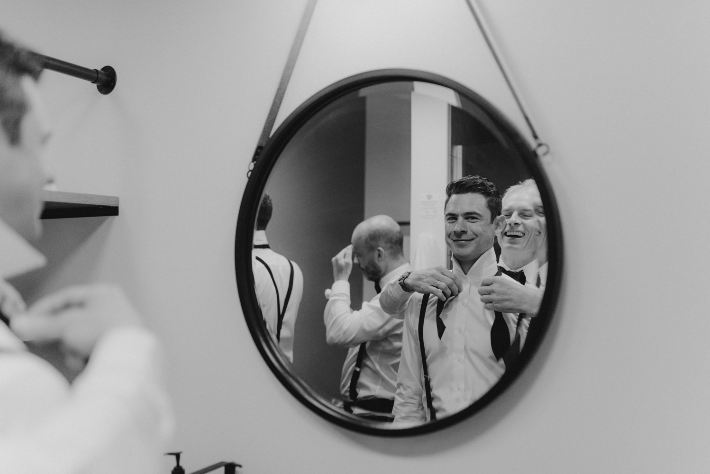 Rush Creek Lodge Wedding, photo of groom getting his bow tie on