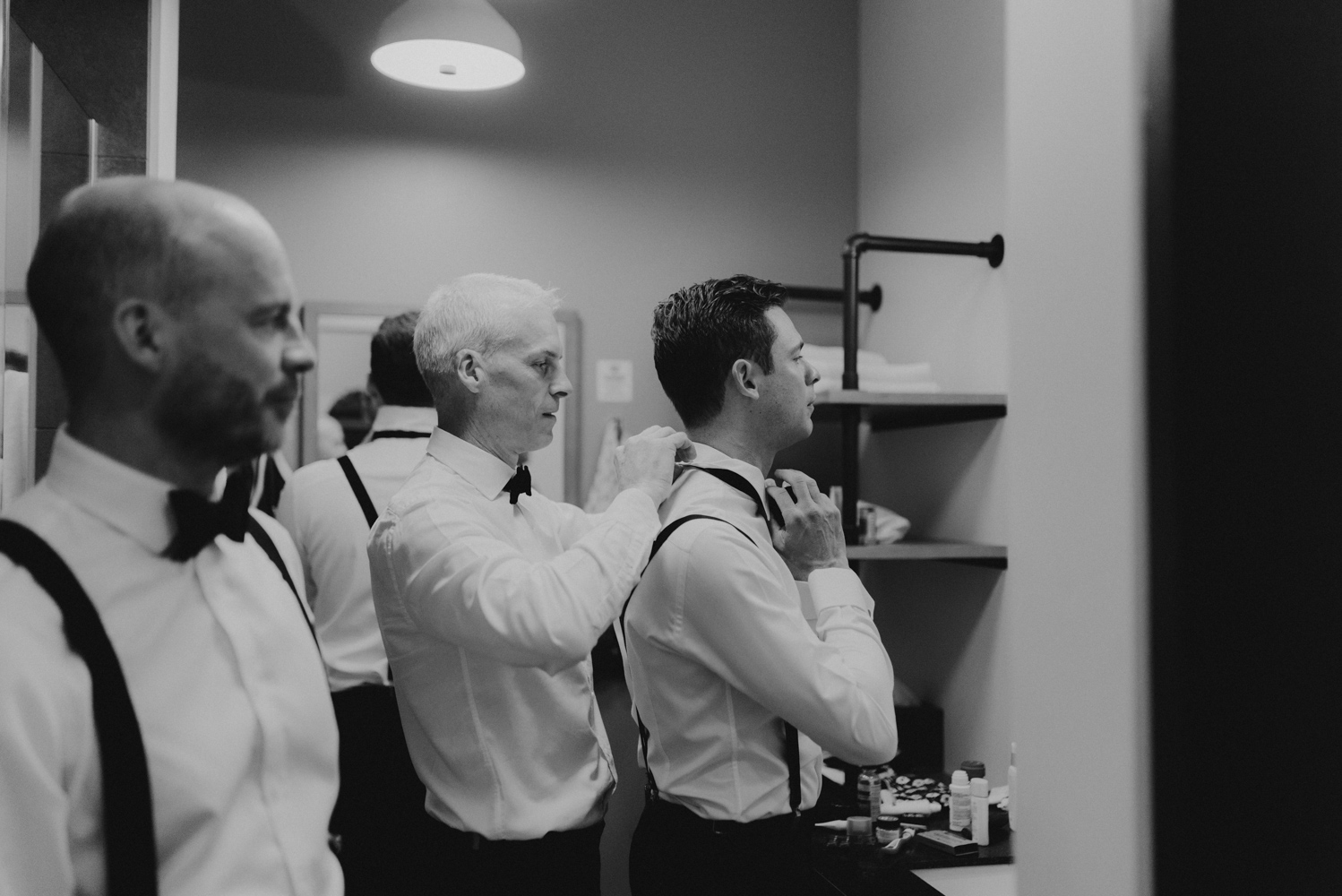 Rush Creek Lodge Wedding, photo of brother helping groom with bowtie