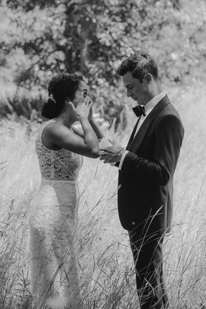 Rush Creek Lodge Wedding, photo of couple reading their vows during their first look