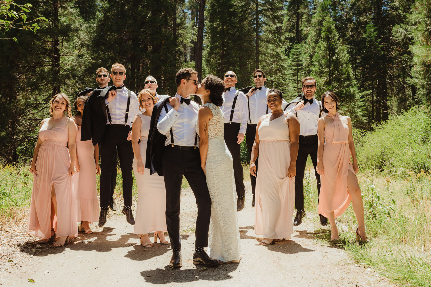 Rush Creek Lodge Wedding, photo of couple kissing with their bridal party behind them