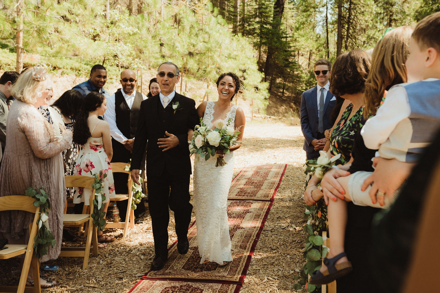 Rush Creek Lodge Wedding, photo of bride walking down the aisle with her dad