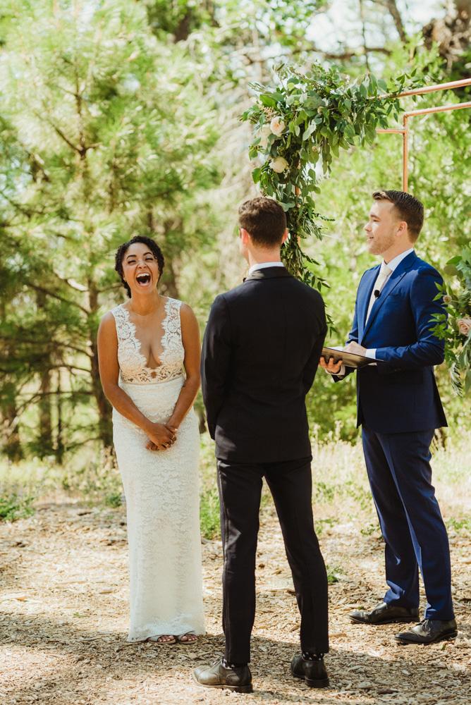 Rush Creek Lodge Wedding, photo of bride laughing photo