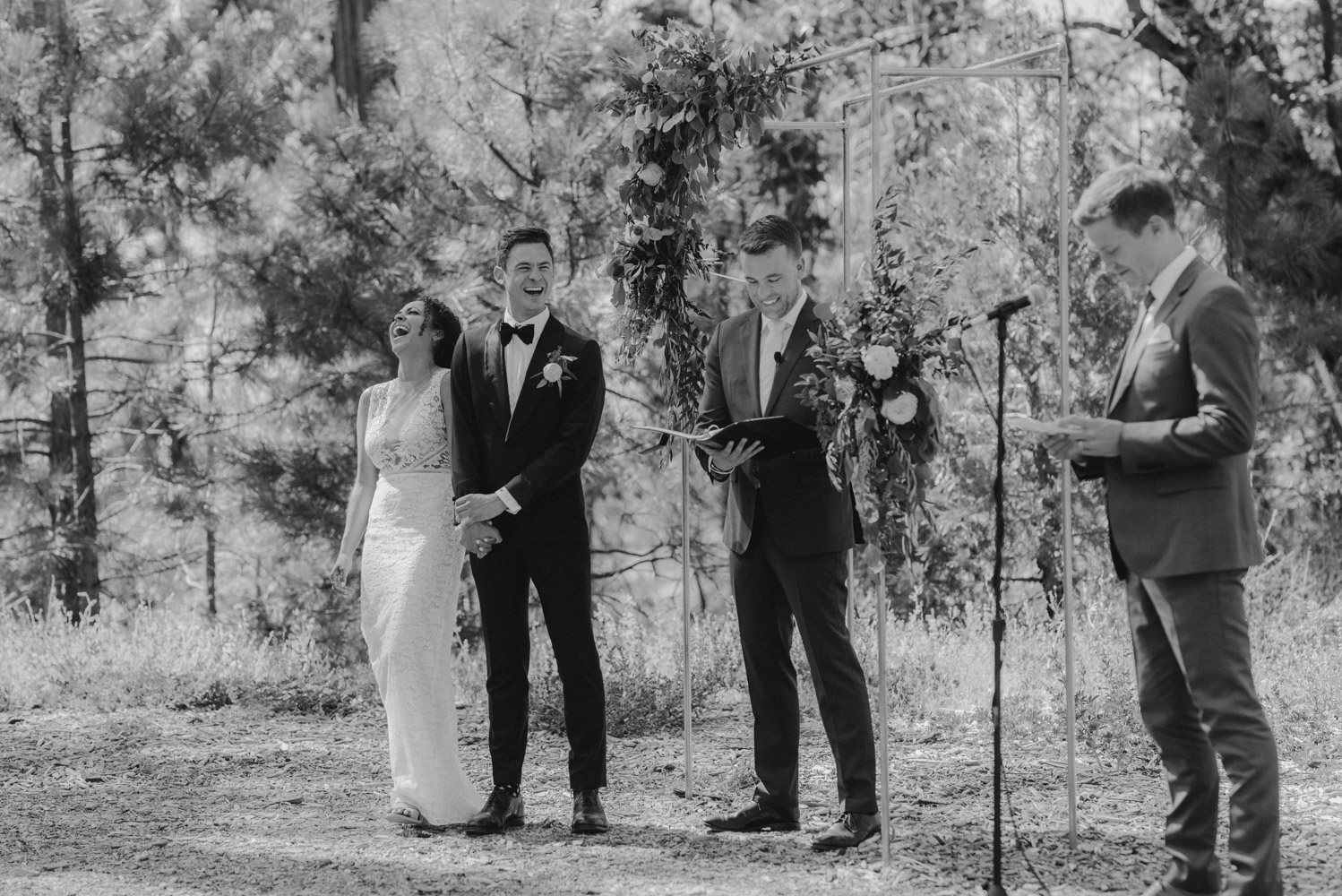 Rush Creek Lodge Wedding, photo of couple at the ceremony, California Love being read to them