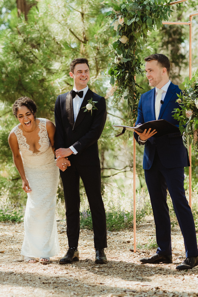 Rush Creek Lodge Wedding, photo of couple laughing while California Love is being read to them
