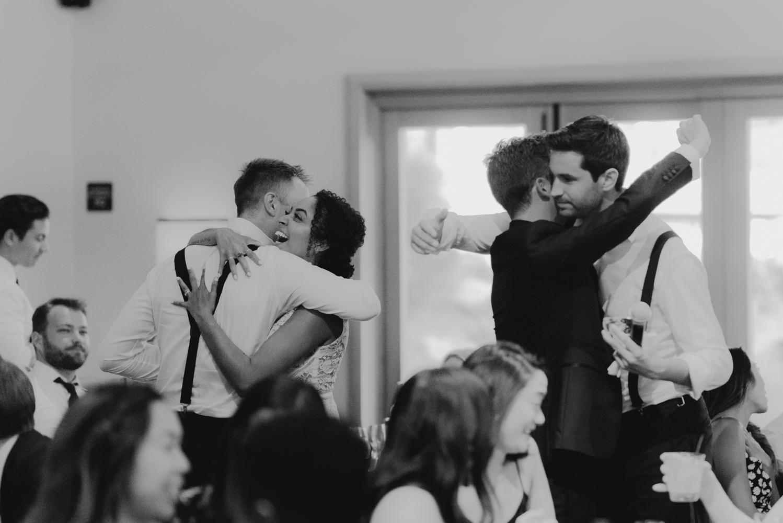 Rush Creek Lodge wedding, couple hugging friends photo