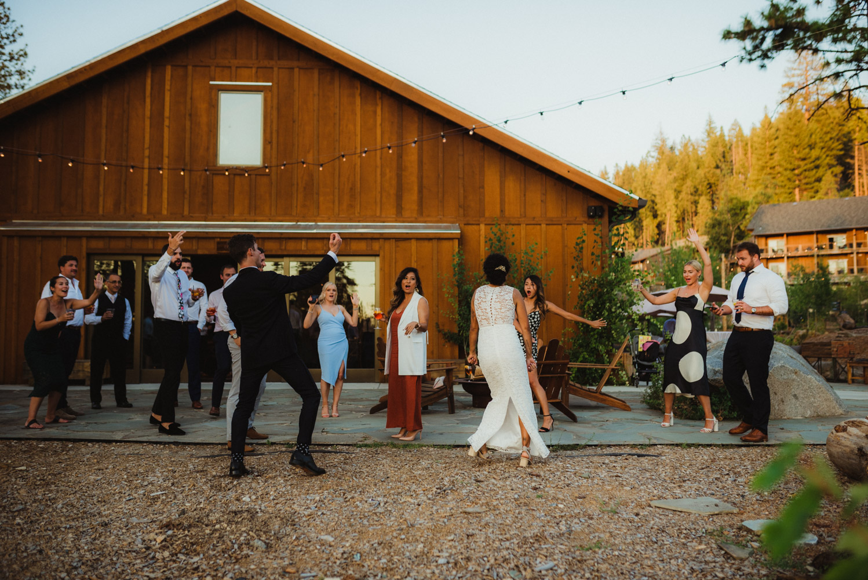 Rush Creek Lodge wedding, couple dancing with friends photo