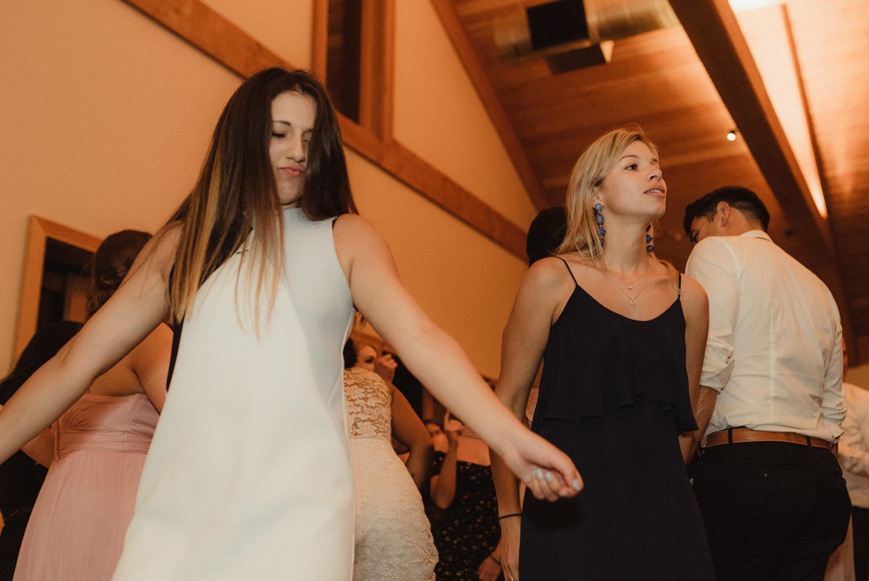 Rush Creek Lodge wedding, girls dancing near the bride and groom photo