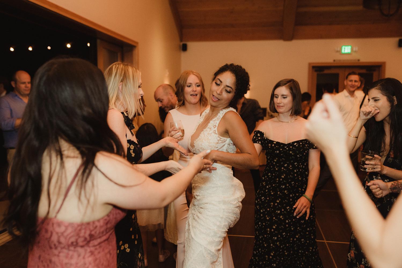 Rush Creek Lodge wedding, bride dancing with her friends photo