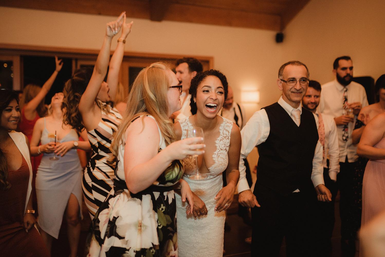 Rush Creek Lodge wedding, bride laughing on the dance floor photo