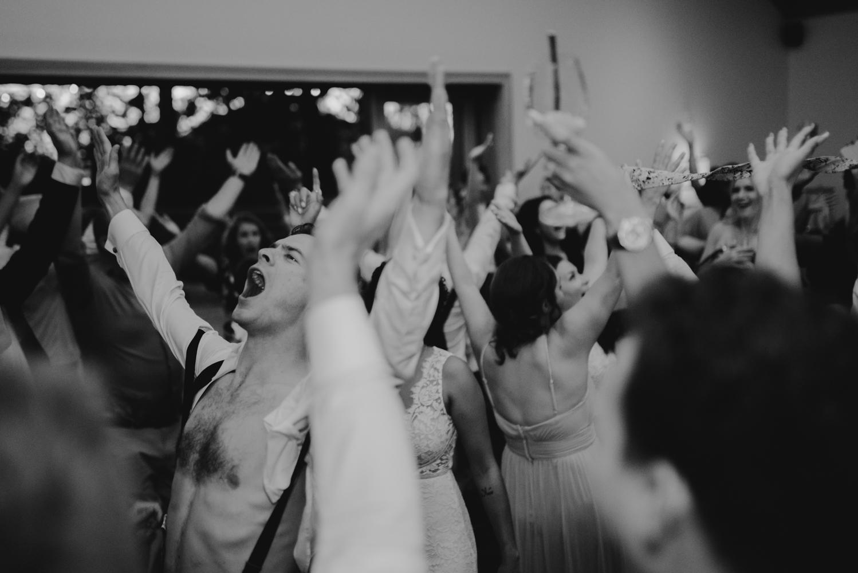Rush Creek Lodge wedding, friends cheering in the air photo