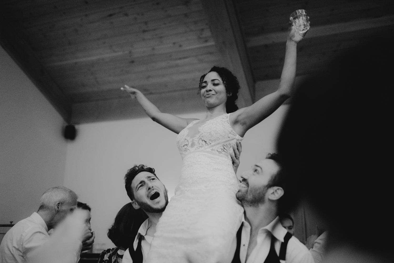 Rush Creek Lodge wedding, bride being raised in the air photo