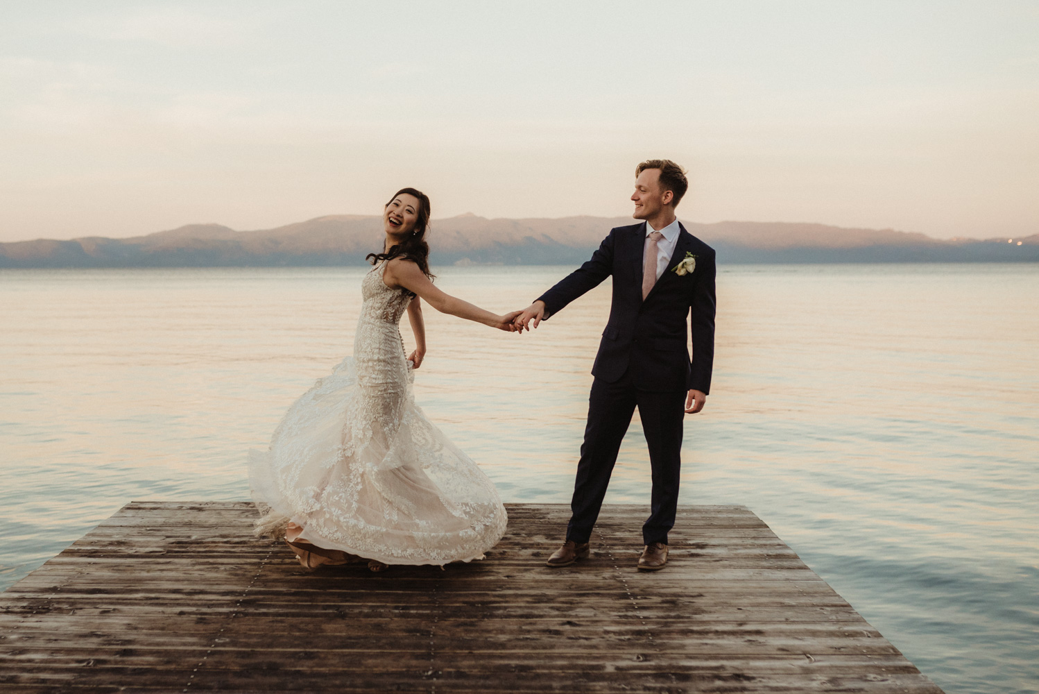 Hellman-Erman Mansion Wedding, photo of couple at sunset on the dock