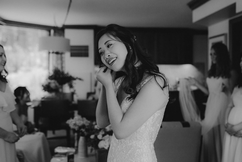 Hellman-Erman Mansion Wedding, photo of bride putting on her earings