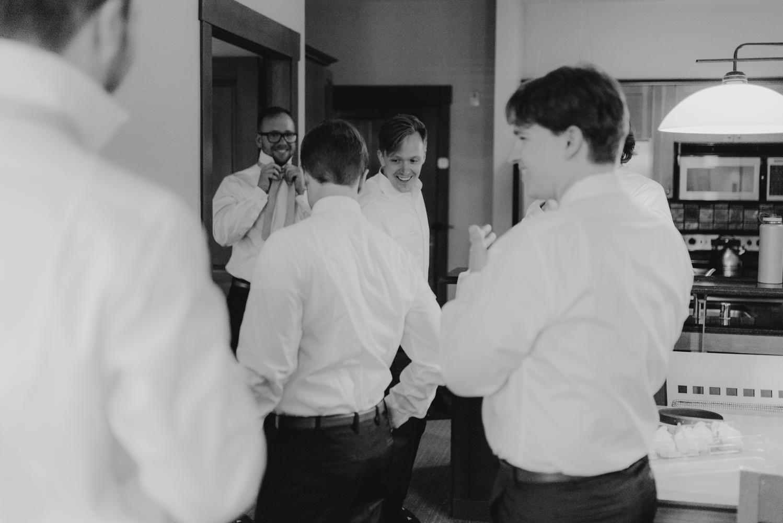 Hellman-Erman Mansion Wedding, photo of groom getting ready with his groomsmen