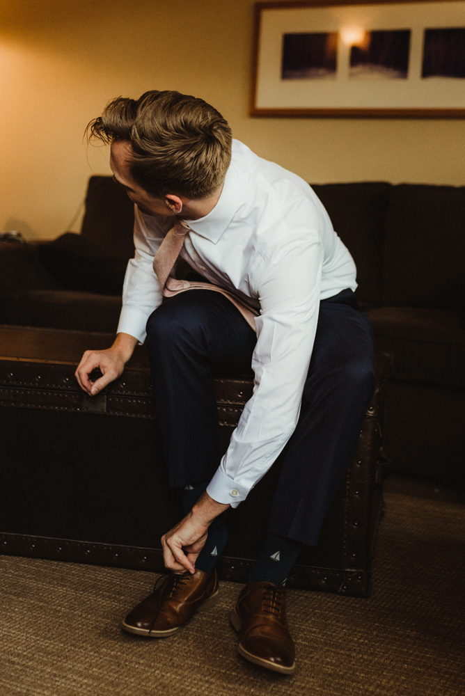 Hellman-Erman Mansion Wedding, photo of groom putting on his shoes photo