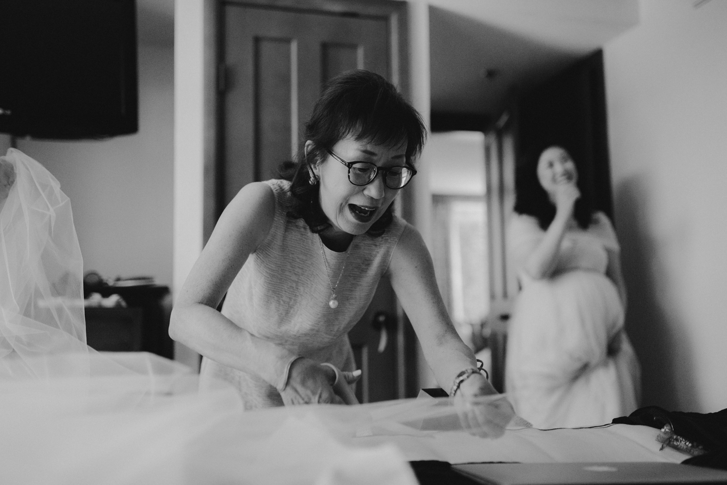 Hellman-Erman Mansion Wedding, photo of mom cutting the veil the day of the wedding