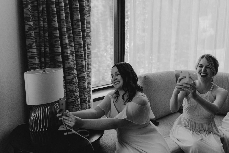 Hellman-Erman Mansion Wedding, photo of bridesmaid taking the brides photo