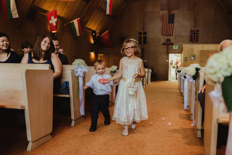 Hellman-Erman Mansion Wedding, photo of flower girl walking down the aisle