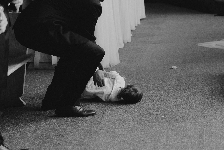 Hellman-Erman Mansion Wedding, photo of kid crying in a catholic church