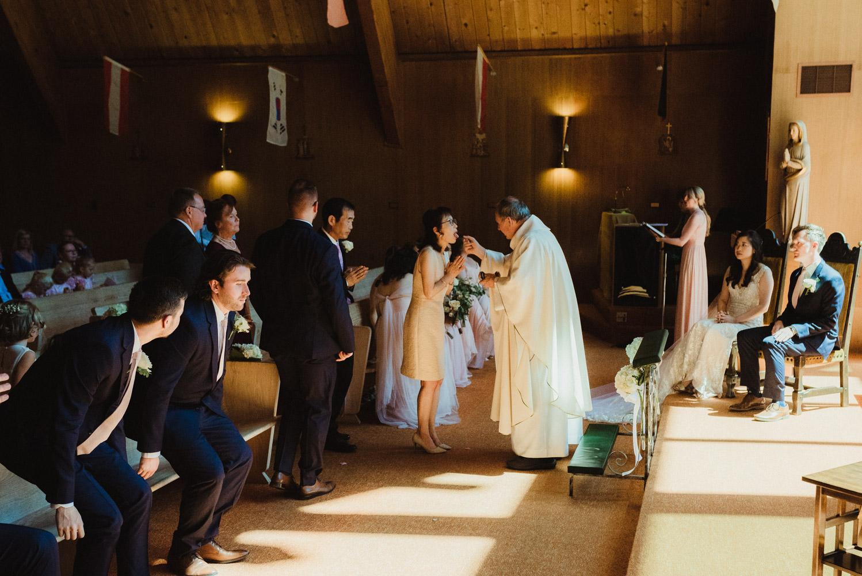 Hellman-Erman Mansion Wedding, photo the brides mom during mass