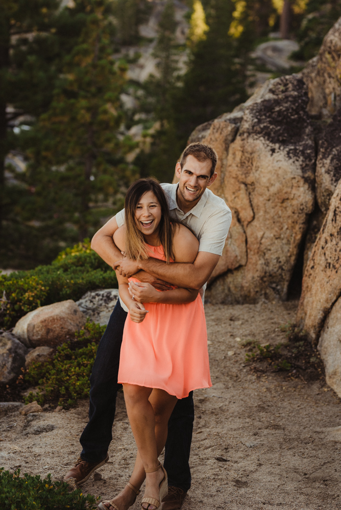 Lake Tahoe Wedding Photographer, photo of couple hugging and lauding on a trail at Donner Pass