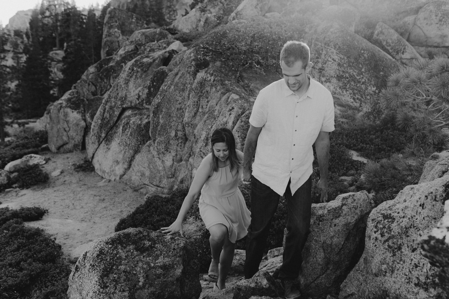 Lake Tahoe Wedding Photographer, photo of couple holding hands walking up granite features