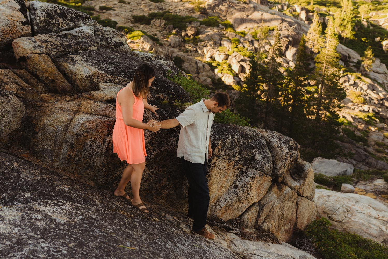 Lake Tahoe Wedding Photographer, photo of couple walking on a rock with bride to be wearing heals