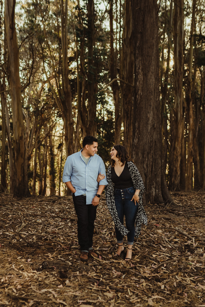 Lyon Steps Engagement Session, photo of couple walking through the forest section