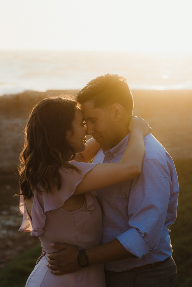 Sutro Baths Engagement Session, photo of couple pressing their foreheads together