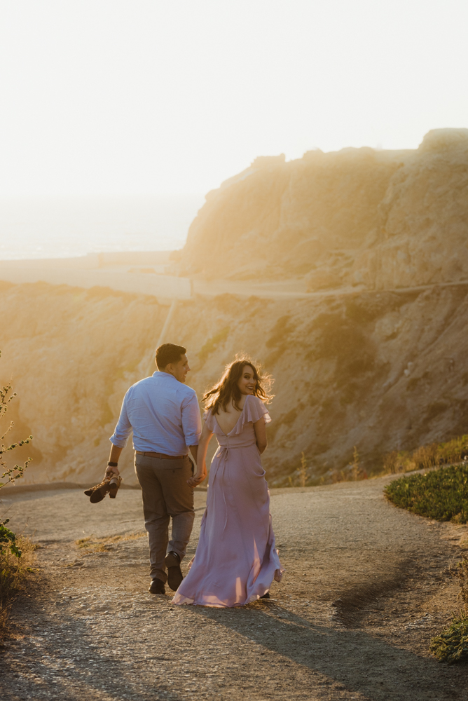 Sutro Baths Engagement Session, photo of couple walking down to the baths