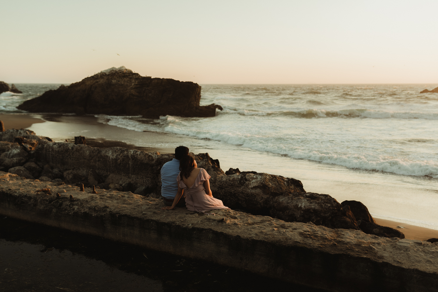 Sutro Baths Engagement Session, photo of couple watching sunset together