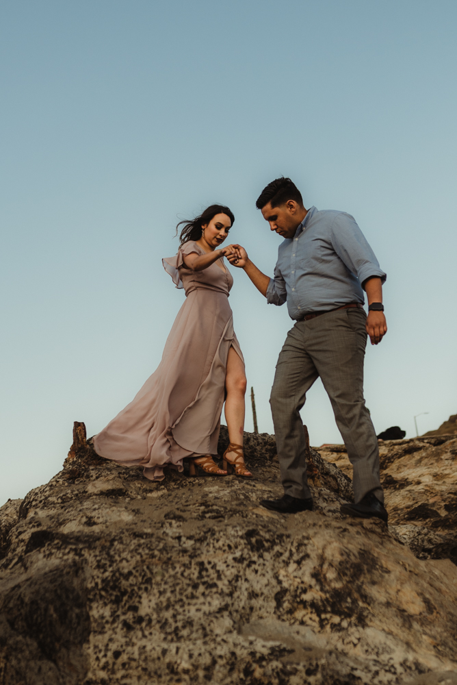Sutro Baths Engagement Session, photo of couple walking down steep rocks
