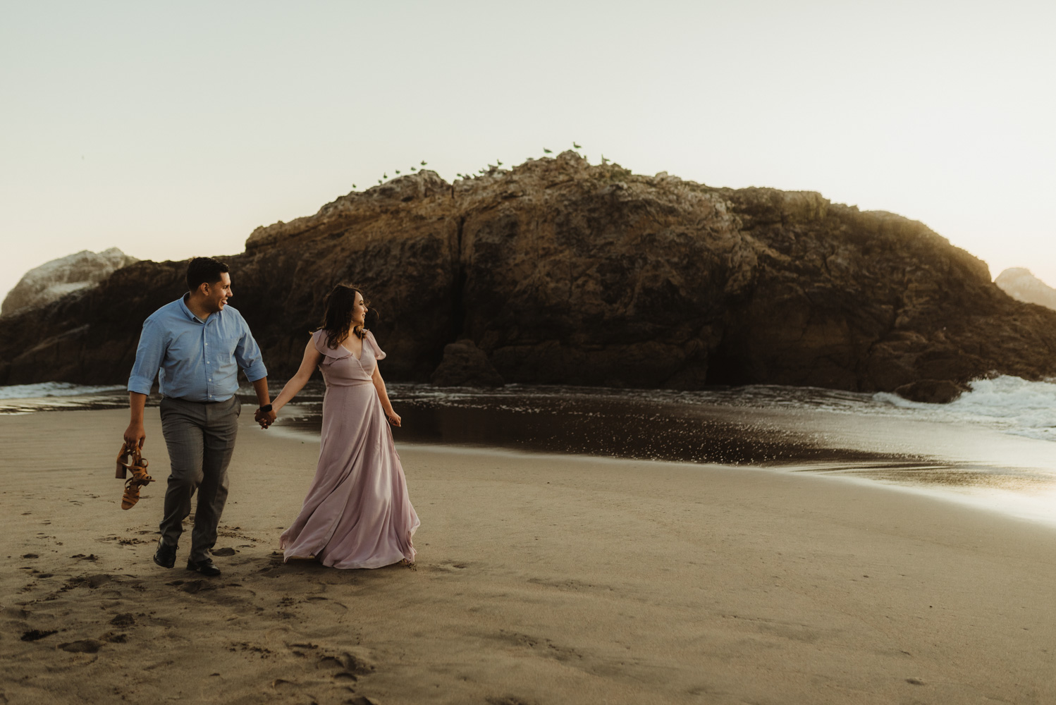 Sutro Baths Engagement Session, photo of couple walking on the shore