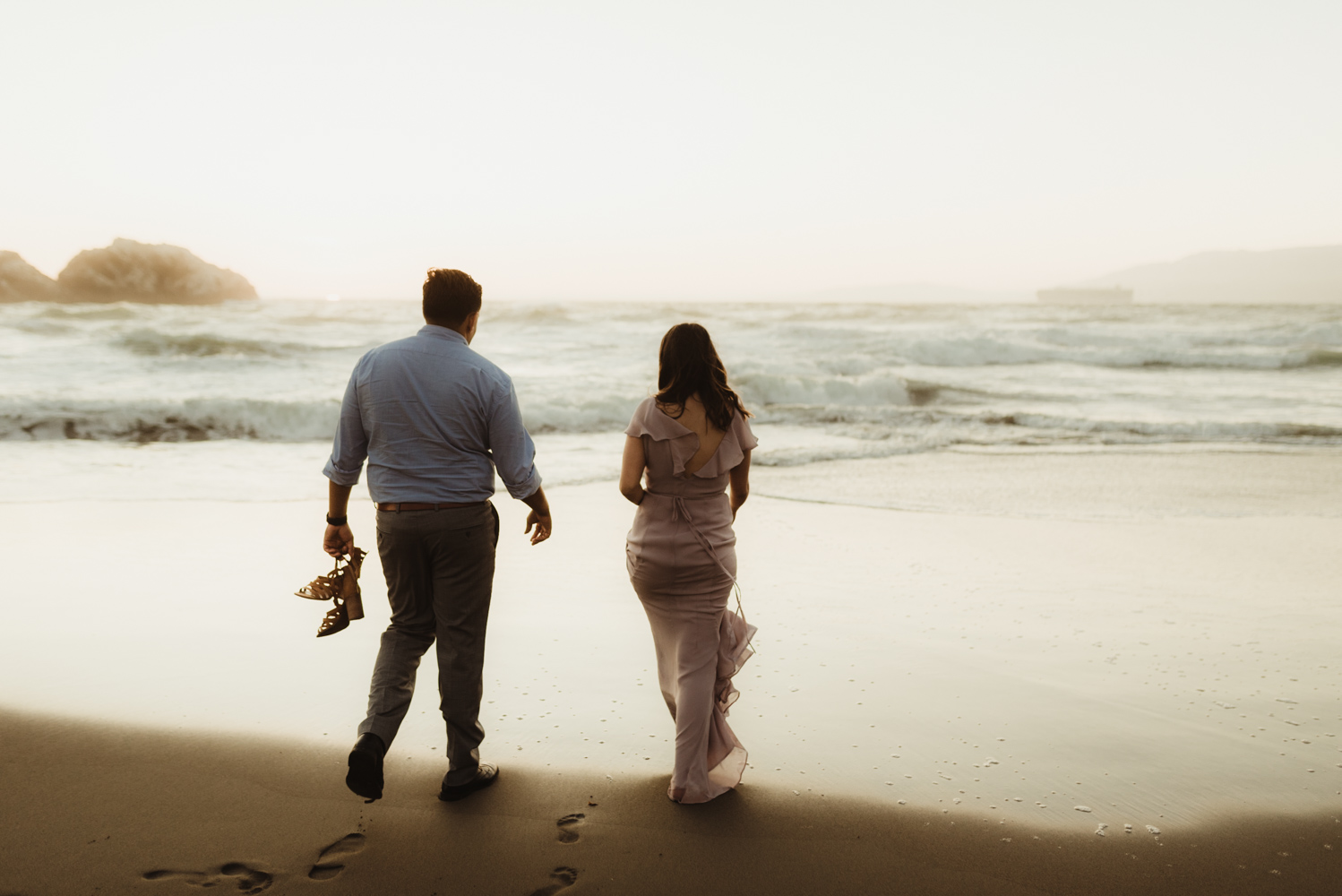 Sutro Baths Engagement Session, photo of couple walking by the ocean