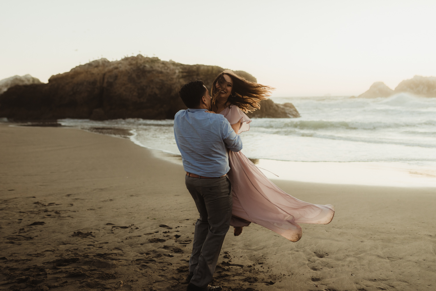 Sutro Baths Engagement Session, photo of girl being swung around