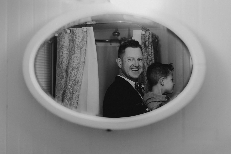 Twenty Mile House Wedding Photographer,  groom seeing himself in the mirror