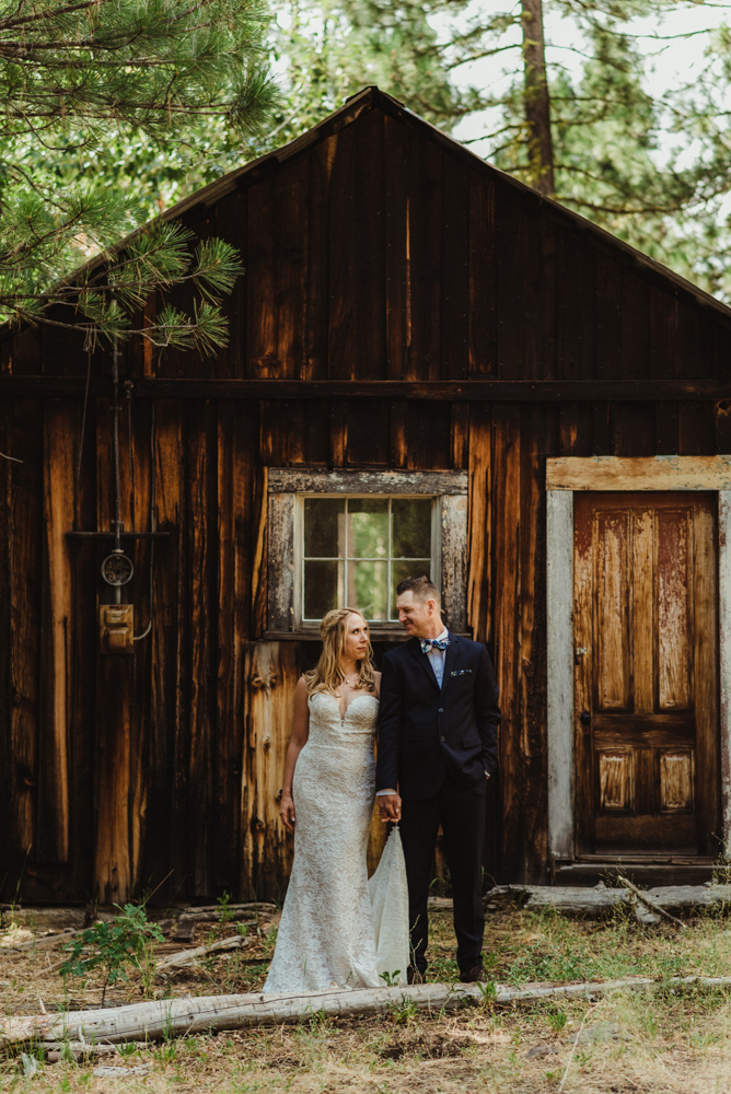 Twenty Mile House Wedding Photographer, couples photo in front of an old mining home