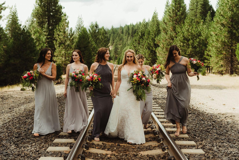 Twenty Mile House Wedding Photographer, photo of bridesmaids and bride on a train track