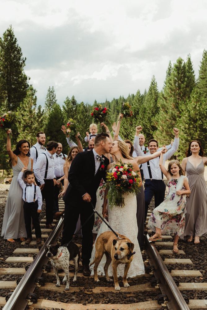 Twenty Mile House Wedding Photographer, photo of couple and bridal party on the train tracks