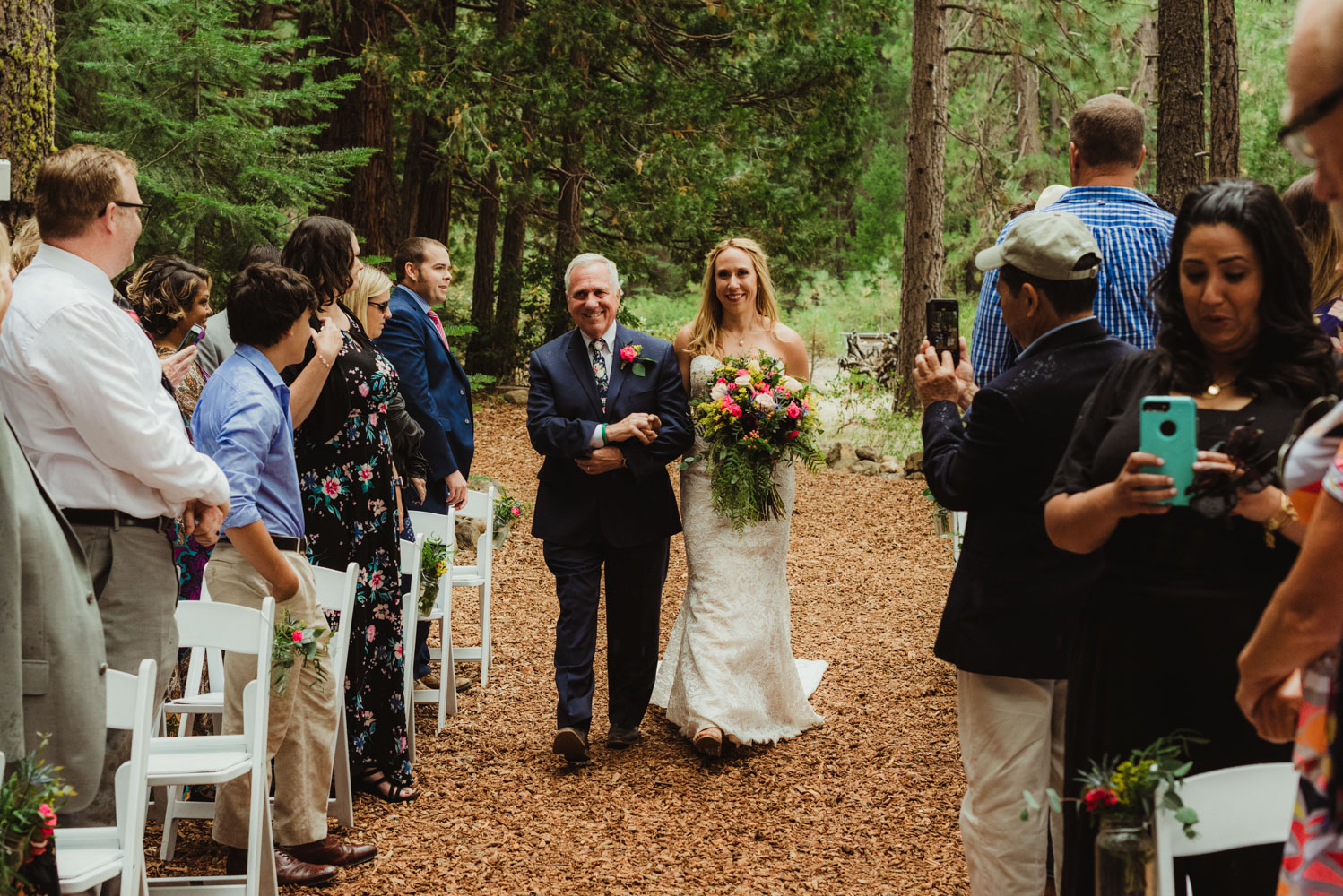 Twenty Mile House Wedding Photographer, bride walking down the aisle with her dad