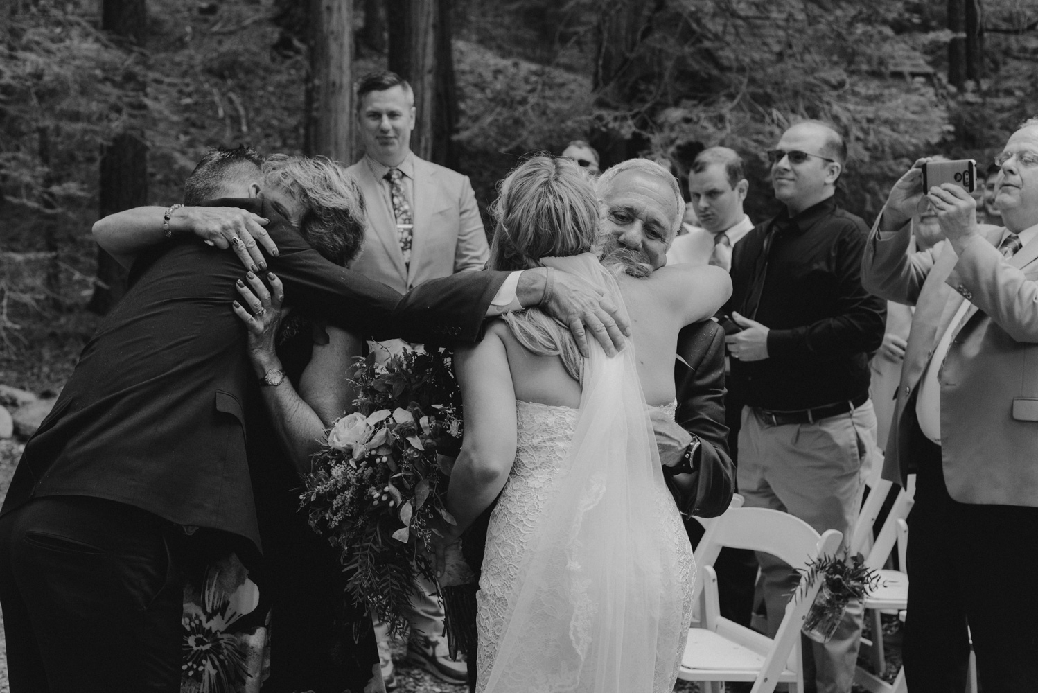 Twenty Mile House Wedding Photographer, bride hugging her dad at the end of aisle