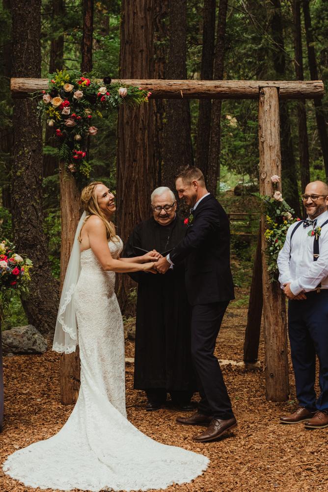 Twenty Mile House Wedding Photographer, bride laughing during the ceremony