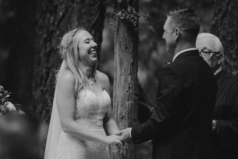 Twenty Mile House Wedding Photographer, bride laughing during her ceremony
