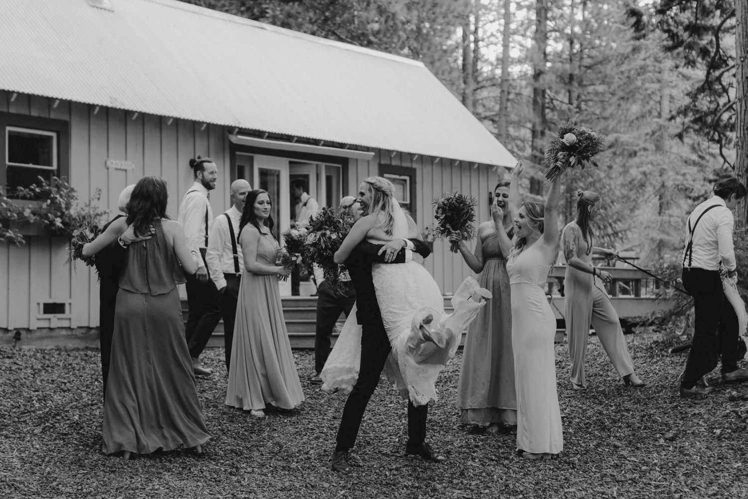 Twenty Mile House Wedding Photographer, bridal party celebrating with brie and groom