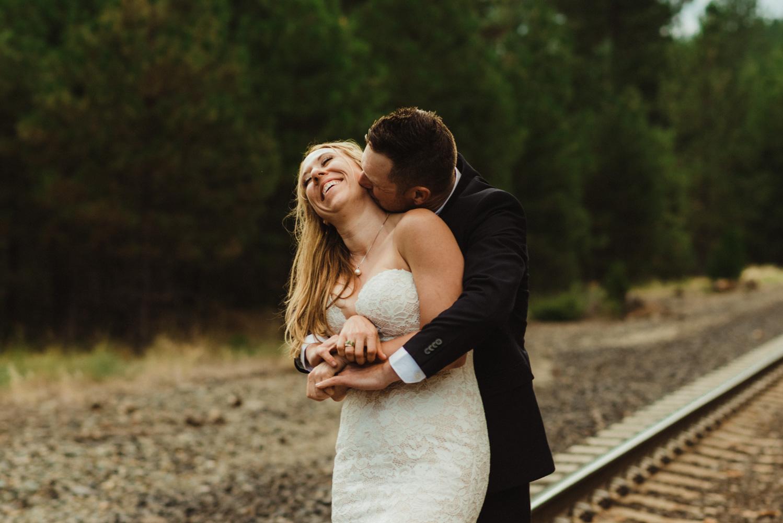 Twenty Mile House Wedding Photographer, photo of couple hugging on the train tracks