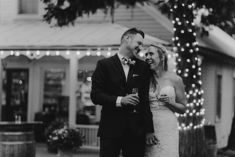 Twenty Mile House Wedding Photographer, couple lauding during toasts