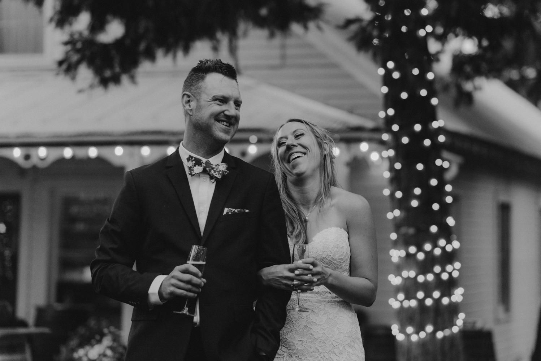 Twenty Mile House Wedding Photographer, couple laughing during the toast