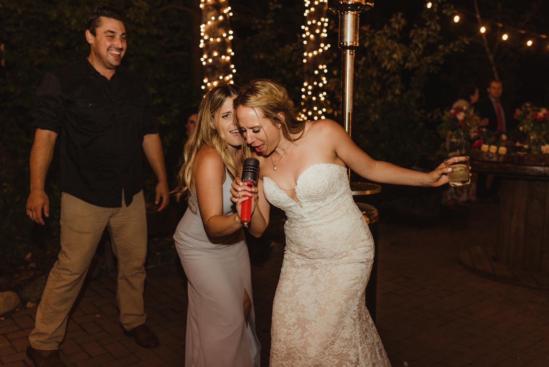 Twenty Mile House Wedding Photographer, photo of bride singing into a plastic microphone