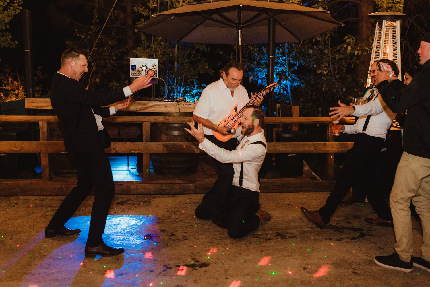 Twenty Mile House Wedding Photographer, photo of guests playing with inflatable instruments