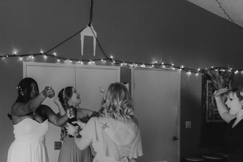 River School Farm Wedding, photo of bridesmaids popping champagne
